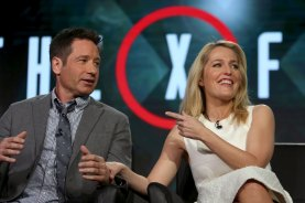 Actors David Duchovny and Gillian Anderson speak during the Fox Network presentation at the Television Critics Association winter press tour in Pasadena, California January 15, 2016. REUTERS/David McNew