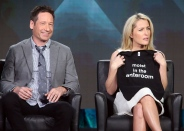 "PASADENA, CA - JANUARY 15: Actor David Duchovny (L) and actress Gillian Anderson speak during the FOX segment for the television show ""The X Files"" at the Langham Hotel on January 15, 2016 in Pasadena, California. (Photo by Frederick M. Brown/Getty Images)"