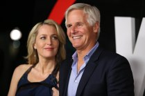 """Gillian Anderson and Chris Carter arrive at the season premiere of """"The X-Files"""" at the California Science Center on Tuesday, Jan. 12, 2016, in Los Angeles, Calif. (Photo by Omar Vega/Invision/AP)"""