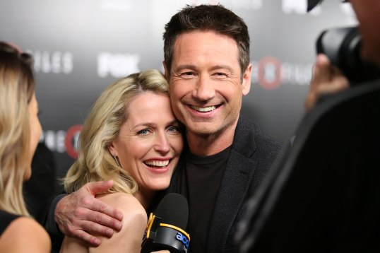Gillian Anderson and David Duchovny laugh during an interview at the season premiere of 'The X-Files' at the California Science Center on Tuesday, Jan. 12, 2016, in Los Angeles, Calif. (Photo by Omar Vega/Invision/AP)