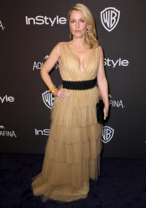 Gillian Anderson arrives at the InStyle and Warner Bros. Golden Globes afterparty at the Beverly Hilton Hotel on Sunday, Jan. 10, 2016, in Beverly Hills, Calif. (Photo by Matt Sayles/Invision/AP)