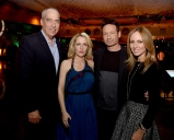 """LOS ANGELES, CA - JANUARY 12: (L-R) Gary Newman, Co-Chairman-CEO, Fox Television Group, actress Gillian Anderson, actor David Duchovny and Dana Walden, Co-Chairman-CEO, Fox Television Group pose at the after party for the premiere of Fox's """"The X-Files"""" at the California Science Center on January 12, 2016 in Los Angeles, California. (Photo by Kevin Winter/Getty Images)"""