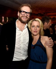 """LOS ANGELES, CA - JANUARY 12: Writer Bryan Fuller (L) and actress Gillian Anderson pose at the after party for the premiere of Fox's """"The X-Files"""" at the California Science Center on January 12, 2016 in Los Angeles, California. (Photo by Kevin Winter/Getty Images)"""